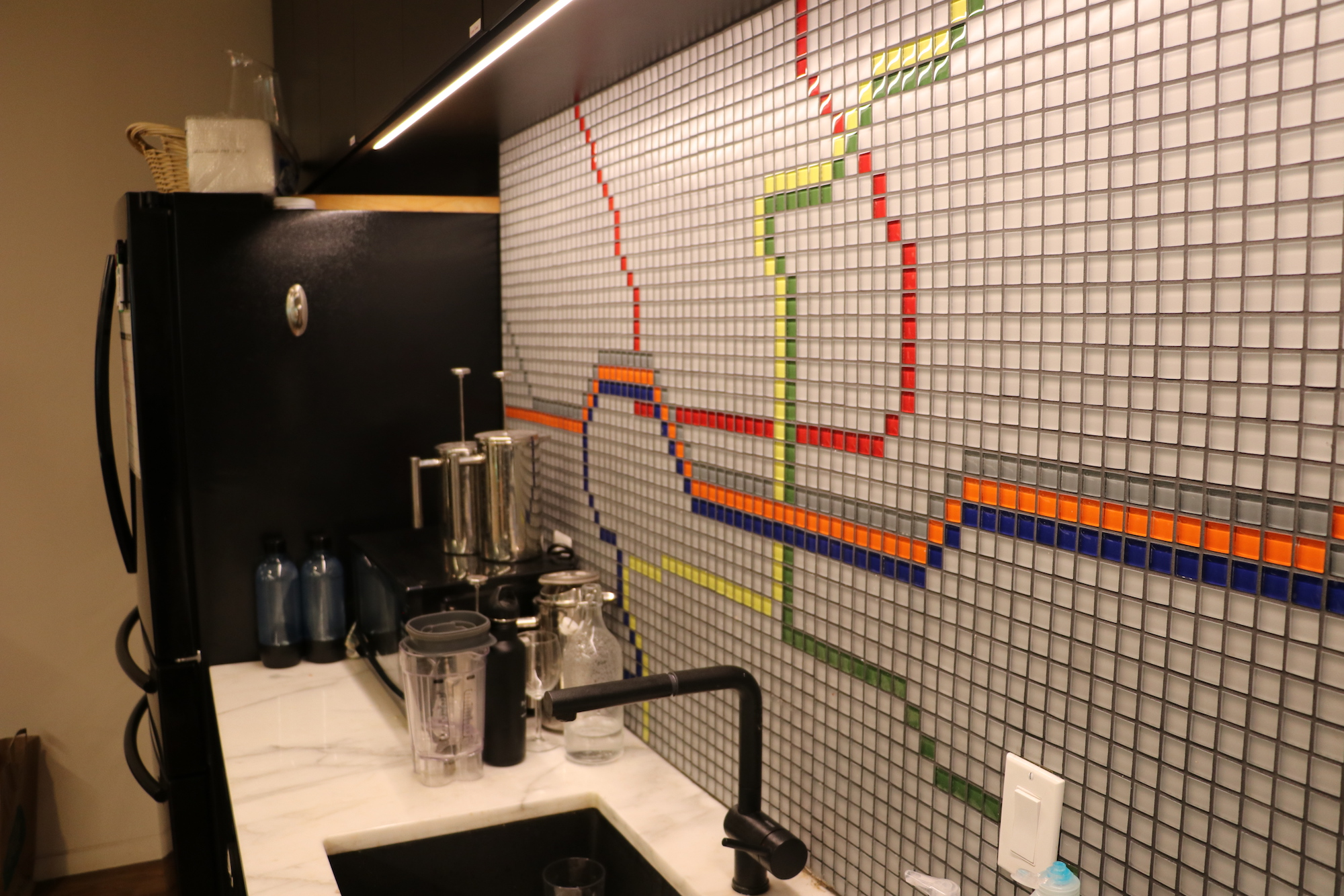 A tile map of the Washington, D.C. Metro system in the kitchen of Quorum's office.
